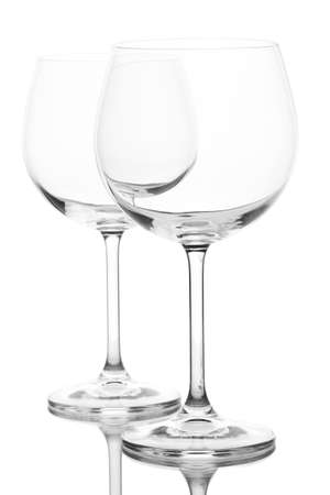 Empty wine glasses arranged and isolated on white
