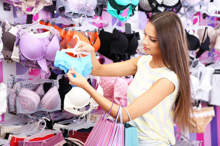 Beautiful young woman in shop with underwear