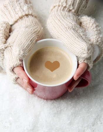 Photo pour Female hands with hot drink, on light background - image libre de droit