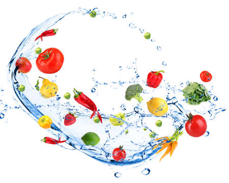 Fresh vegetables with water splash, isolated on whiteの写真素材