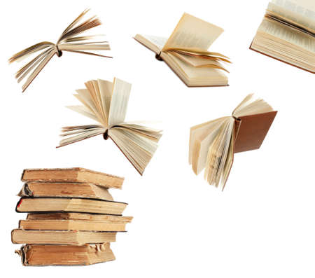 Photo pour Flying books isolated on white - image libre de droit