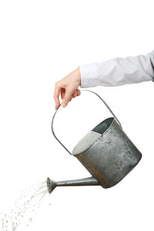 Hand of businesswoman pouring water from watering can isolated on white