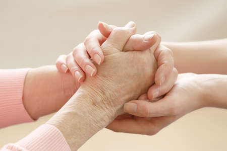 Photo pour Helping hands, care for the elderly concept - image libre de droit