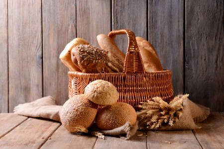 Different bread on table on wooden background