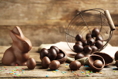 Photo for Chocolate Easter Eggs on wooden background - Royalty Free Image