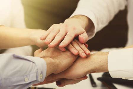 Foto für United hands of business team on workspace background - Lizenzfreies Bild