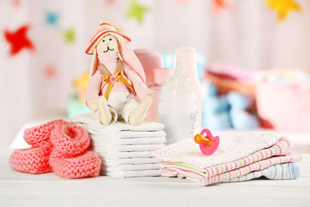 Photo pour Baby accessories on table on light background - image libre de droit