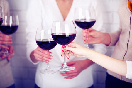 Photo for Woman hands with glasses of wine close-up - Royalty Free Image