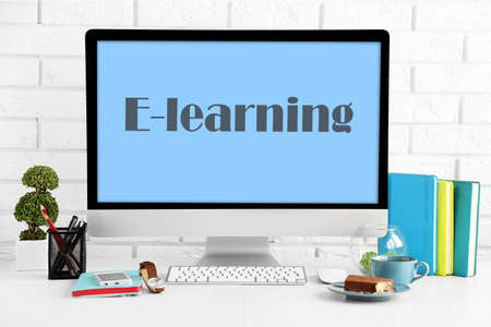 E-learning concept with computer and books on the table