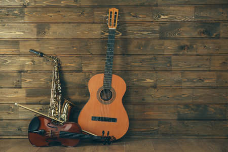 Musical instruments on wooden planks background