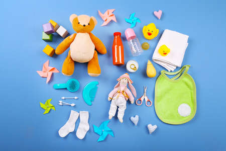 Baby collection on blue background, top view