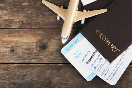 Airline tickets and documents on wooden background