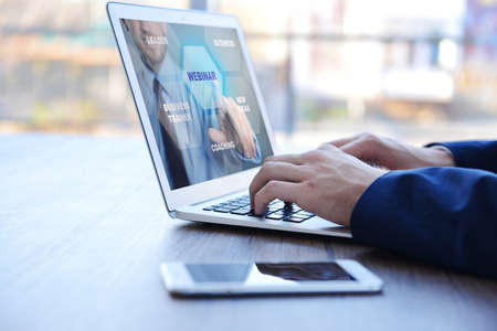 Man video conferencing on laptop. Webinar and consultation online. Modern business technology concept.