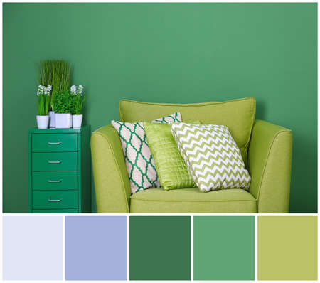 Cozy armchair with pillows on wall background. Palette with green color