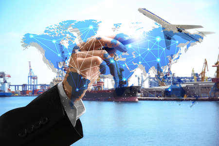 Photo pour Logistic concept. Man working with virtual screen and seaport on background - image libre de droit