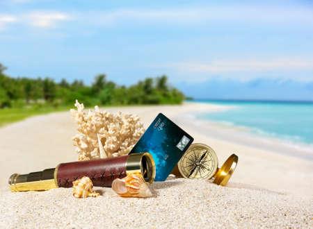 Foto de Composition with credit card on tropical beach - Imagen libre de derechos