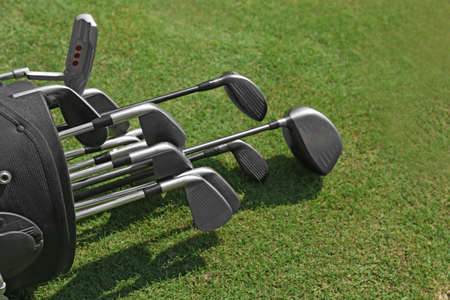 Photo for Golf bag with clubs on green field, close up - Royalty Free Image