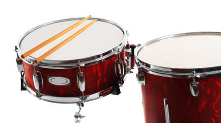 Red drums with drum sticks isolated on white background