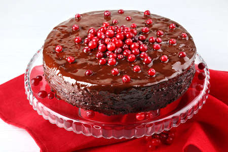 Chocolate cake with cranberries and napkin, closeup