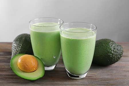 Avocado smoothie on grey background