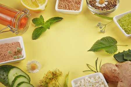 Frame Of Natural Ingredients For Skin Care On Yellow Background Royalty Free Images Photos And Pictures