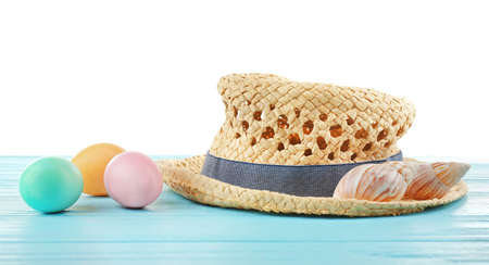 Easter eggs with hat, on white background