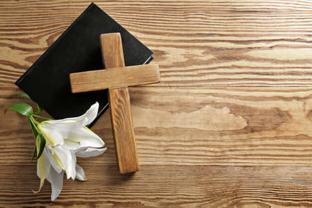 Photo for Wooden cross, Holy Bible and white lily on table - Royalty Free Image