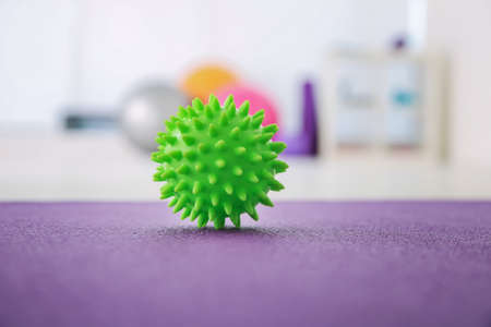 Pimply stress ball on floor in clinic