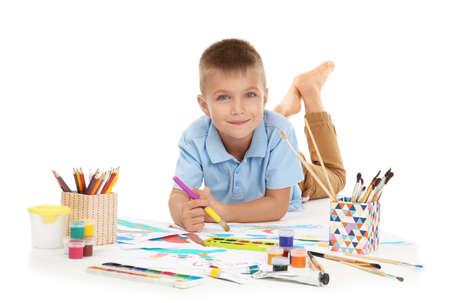 Photo pour Cute little boy painting against white background - image libre de droit