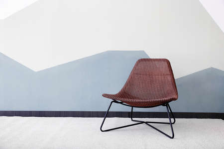 Foto de Stylish armchair against color wall background - Imagen libre de derechos