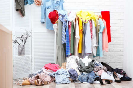 Photo for Messy dressing room interior with clothes rack - Royalty Free Image