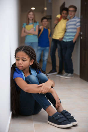 Photo for Sad African American girl indoors. Bullying in school - Royalty Free Image
