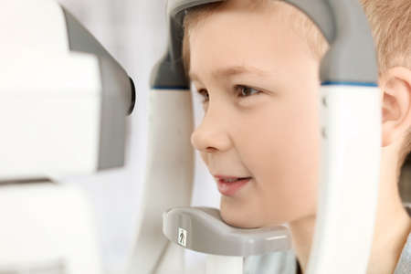 Little boy visiting ophthalmologist in clinic