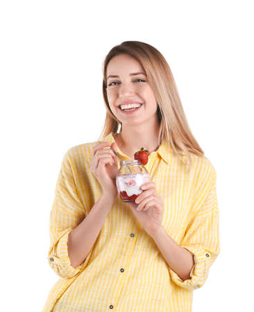 Young attractive woman eating tasty yogurt on white background