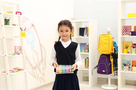 Foto de Cute child choosing school stationery in store - Imagen libre de derechos