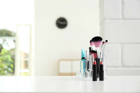 Photo pour Organizer with makeup cosmetic products on table indoors. Space for text - image libre de droit