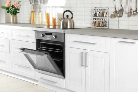 Foto per Open modern oven built in kitchen furniture - Immagine Royalty Free