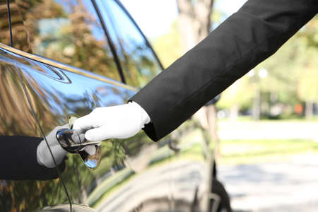 Photo for Driver opening car door, closeup. Chauffeur service - Royalty Free Image