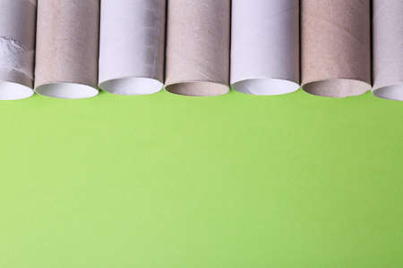 Empty toilet paper rolls and space for text on color background