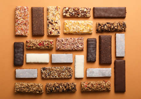 Photo for Flat lay composition with protein bars on color background - Royalty Free Image
