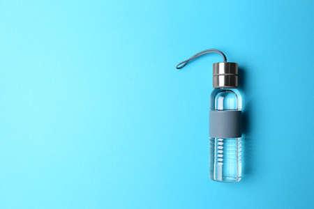 Photo pour Sport bottle with space for text on color background, top view - image libre de droit