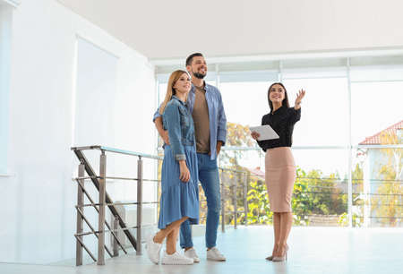 Photo for Female real estate agent showing new house to couple, indoors - Royalty Free Image