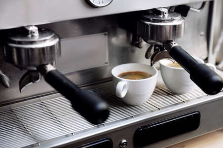 Photo for Coffee machine with cups on drip tray, closeup - Royalty Free Image