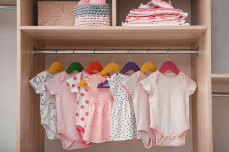 Photo pour Wardrobe with cute baby clothes and home stuff - image libre de droit