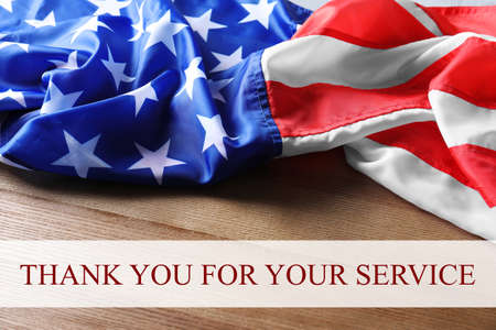 Photo pour Text THANK YOU FOR YOUR SERVICE and USA flag on wooden background - image libre de droit