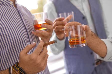 Photo for Group of friends drinking whiskey together indoors, closeup - Royalty Free Image