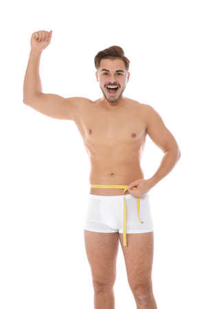 Fit Man Measuring His Waist On White Background Weight Loss Royalty Free Images Photos And Pictures