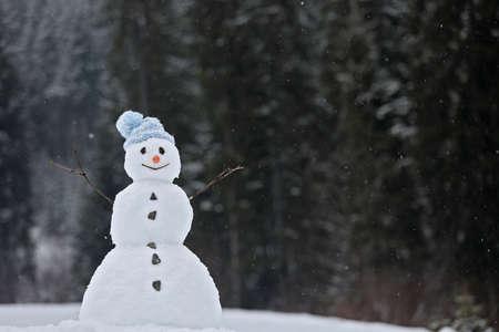 Foto de Adorable smiling snowman outdoors on winter day. Space for text - Imagen libre de derechos