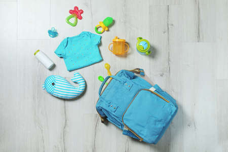 Flat lay composition with baby accessories on wooden background