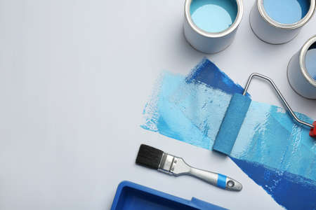 Photo for Composition of blue paint cans and space for text on white background - Royalty Free Image